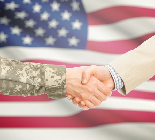Military personnel shaking hands.